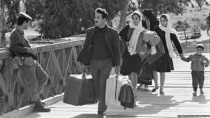 Family of Palestinian refugees heading to Baqaa camp in East Jordan (1970)