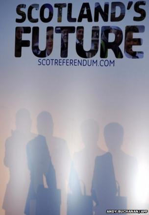 The shadows of Scotland's first minister Alex Salmond and deputy first minister Nicola Sturgeon during a press conference