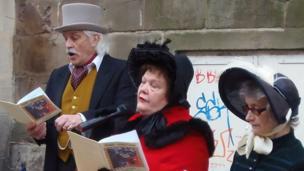 Carol-singers wearing hats