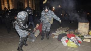 Police detain a protester