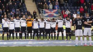 Rangers and Falkirk players observe a minutes silence for the victims of the helicopter crash, before the Fourth Round William Hill Scottish Cup match at Falkirk Stadium