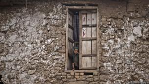An Afghan refugee in a poor neighbourhood of Islamabad