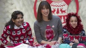 Samantha Cameron, the wife of Britain's Prime Minister David Cameron, attends a jumper decoration workshop in east London on December 4, 2013.