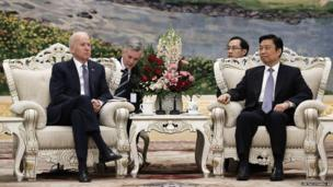 US Vice-President Joe Biden, left, talks with Chinese Vice-President Li Yuanchao at the Great Hall of the People on December 4, 2013, in Beijing, China.