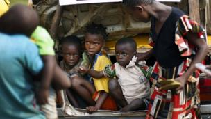 Christian children from the village of Bouebou, some 40km north of Bangui, are packed in the trunk of a taxi to flee sectarian violence on 4 December, 2013