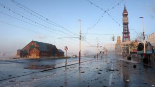 Debris from the sea is strewn across the road after a high tide in Blackpool, north west England, on December 5, 2013 as high winds hit the north of England and Scotland.