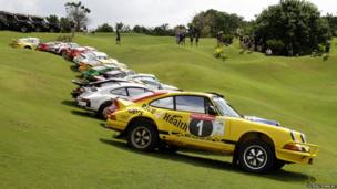Cars line-up ahead of rally start at golf course