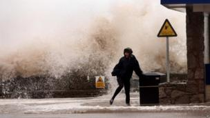 A Woman by a wave in Rhyl