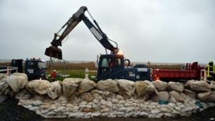 Embankment in Cuxhaven-Sahlenburg, northern Germany being reinforced against flooding (5 Dec)