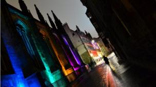 Photo taken on a night walk around Edinburgh old town, looking up Castlehill by Stephen Hinde. He says it is great contrast of colour