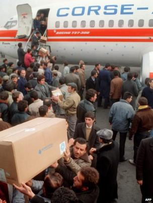 Unidentified helpers unload medical supplies, on December 10, 1988, from the non-governmental French humanitarian association 'Medecins du Monde'