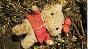 A cuddly toy lies amongst debris after the storm surge hit Saltburn