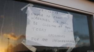 A sign is displayed in a shop window in Whitby