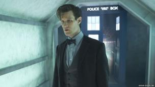 Matt Smith as the Doctor stands in front of the Tardis