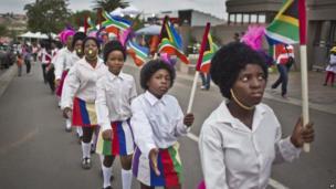 Children march up Vilakazi Street in Soweto (7 Dec)