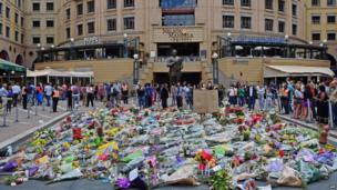 Flowers left in Nelson Mandela Square in Sandton, Johannesburg