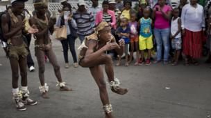 Dance troupe from Kiptown perform outside old Mandela home in Soweto (7 Dec 2013)