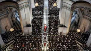 The coffin bearing the body of Baroness Margaret Thatcher is carried into St Paul's Cathedral on 17 April