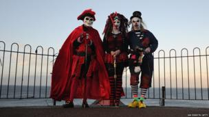 Mike Kershaw from Sheffield, Valery Bailey from Rotherham and her husband Tony Bailey pose for a photograph at the Goth weekend on 2 November 2013, in Whitby, England