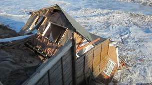 One of the five bungalows in Hemsby, Norfolk which fell into the sea as the tidal surge caused the cliff to break up