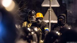 Protesters wear gas masks