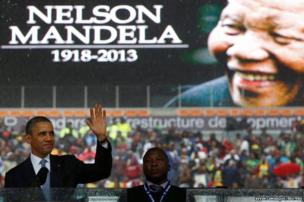 US President Barack Obama addresses the crowd during a memorial service for Nelson Mandela
