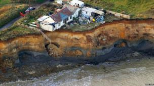 The last house on the cliff at Happisburgh needs to be demolished following the tidal surge