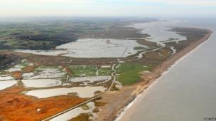 Flooded marshland at Salthouse looking towards Blakeney