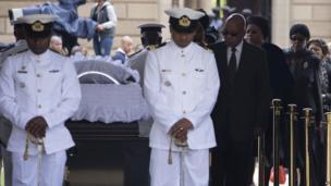 Jacob Zuma, Graca Machel and Winnie Mandela approach Nelson Mandela's coffin
