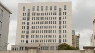 General view of a 12-storey building alleged in a report on 19 February 2013 by the Internet security firm Mandiant to be the home of a Chinese military-led hacking group in Shanghai's northern suburb of Gaoqiao