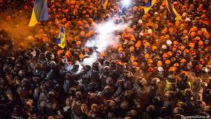 Riot police clash with pro-EU protesters on Independence Square in Kiev