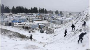 Syrian refugees play with snow during a winter storm in Zahle town, in the Bekaa Valley in Lebanon (11 December 2013)