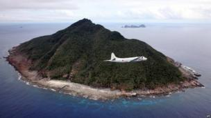 This photo taken on 13 October 2011 shows a P-3C patrol plane of Japanese Maritime Self-Defense Force flying over the disputed islets known as the Senkaku islands in Japan and Diaoyu islands in China, in the East China Sea