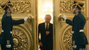 Russian President Vladimir Putin enters the St George Hall of the Grand Kremlin Palace in Moscow