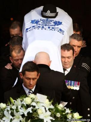 The coffin of PC Kirsty Nelis is carried from the Cathedral following her funeral at St Andrews Cathedral, Glasgow