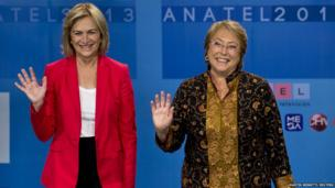 Chilean presidential candidates Michelle Bachelet and Evelyn Matthei wave to the media during a live televised debate in Santiago