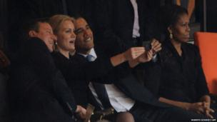 US President Barack Obama, British Prime Minister David Cameron and Denmark's Prime Minister Helle Thorning Schmidt take a selfie at Nelson Mandela memorial service