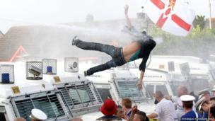 Protestor hit by water cannon