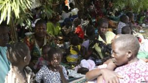 Civilians rest inside the United Nations compound on the outskirts of the capital Juba