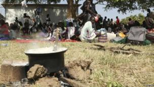 Civilians crowd inside the United Nations compound on the outskirts of the capital Juba