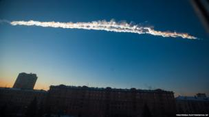 """File photo provided by Chelyabinsk.ru, shows a meteorite contrail over the Ural Mountains"""" city of Chelyabinsk, about 930 miles east of Moscow, Russia."""