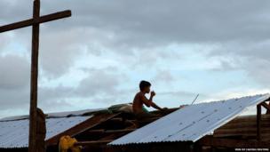 A typhoon survivor drinks coffee