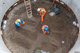 Archaeologists working for Crossrail and the Museum of London dig at a burial site