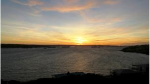 Sunset over Milford Haven harbour