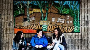 Chilling out - a photo of teenagers on a chair at a bus terminal