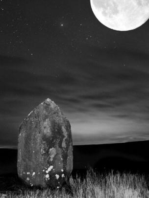 Maen Llia standing stone by moonlight near Ystradfellte, taken by Geoff Moss from Troedyrhiw whilst out walking with his faithful companion