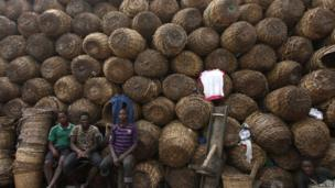 Labourers rest in front of baskets in Lagos, Nigeria, on 16 December 2013