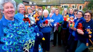 Paignton Zoo volunteers with the knitted animals