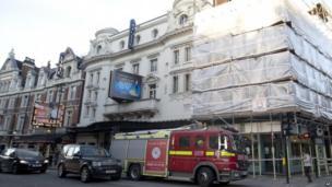 A fire brigade truck waits outside The Apollo Theatre