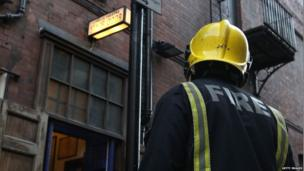 A fireman stands guard outside the stage door